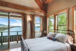 Master bedroom with Queen bed, private deck outside.