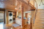 Laundry room, small kitchenette area and stairs to `open alcove` bedroom and formal bedroom 5.