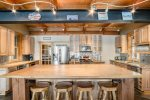 All wood kitchen bar for enjoying breakfast or conversing with the chef.