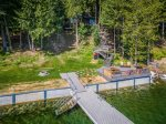 Waterfront property with large dock and kayaks