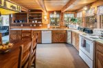 Living room with great views of the lake and large TV.