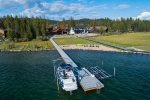 Private dock with 2 high end boat lifts and warm, shallow swimming area.