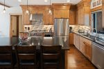 Large gourmet kitchen with granite countertops.