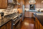 Gas range in a kitchen that is fully appointed.
