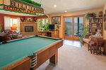 Downstairs area with TV and pool table