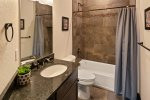 Private covered patio with furniture and Weber natural gas barbeque