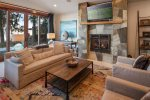 Family room with views and gas fireplace.
