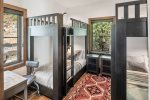 Third bedroom offers 4 twins in two bunk beds with reading light and charging arera.
