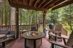 Outdoor covered deck with fire table, Green Egg bbq & propane bbq.