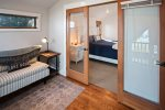 The upstairs landing outside the master suite boasts seating area to relax and read while taking in the beautiful view.