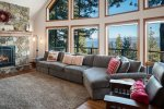 Living room with vaulted ceiling and a gas fireplace is ideal for entertaining.