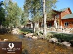 On the River with Mountain Views! Close to on site Pool and Hot Tubs, Walk to Downtown.