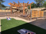Outdoor Fireplace Area, Hot Tubs, and Game Area
