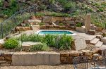 Cliffside condo by onsite hot tub. Dog-friendly. Ground level.