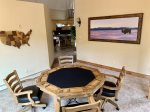 Game table with door wall view of river and wrap around deck