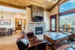 Luxury townhome with Continental Divide views, balcony, and grill. Steps from hot tub & fire pit. 5-minute walk to downtown.