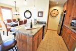 Fully equipped kitchen, granite counters, stainless appliances