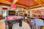RECREATION ROOM WITH TV, POOL TABLE, FIRE PLACE AND WET BAR