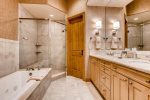 LOWER LEVEL MASTER BATHROOM WITH SHOWER AND BATHTUB