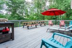This deck has loads of seating and a large gas grill.
