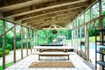 The pool house is entirely screened in... with a fan to help keep you cool.