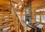 Log stairway to loft and Master Suite