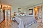 Master Bedroom with luxurious bedding, Tempurpedic King bed, smart TV and views of the aspen grove/mountain range.