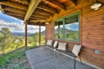 Enjoy a covered and even more secluded view from the lower level patio off the family room.