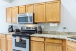 Open kitchen w/ granite counter tops and stainless steel appliances