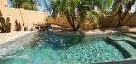 View of golf course, lake and backyard patio with swimming pool from your private master balcony