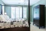 Master suite w/ TV hidden in armoire