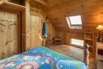 Bedroom in the cabin house with a queen bed.