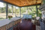 Screened in porch connected to the main house.