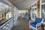 The wrap around porch ocean side with seating and the propane grill.