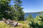 Outdoor sitting area with views of the Kennebec River.