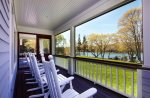 Screened in porch with views of the Pemaquid.