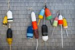 The buoy collection hanging on the deck by the eating area as fun Maine themed decoration.