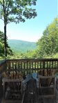 Back deck with ample seating and mountain view