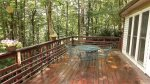 Furnished back deck in peaceful wooded setting