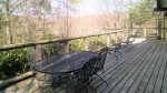 Large back deck off of dining area with ample outdoor seating
