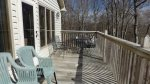 Back deck off of Living Room with outdoor seating and gas grill