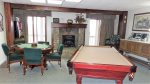 Recreation Room has gas stove and sliding glass door access to bottom deck with hot tub