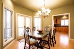 Main Level: Dining Room with french door access to side porch