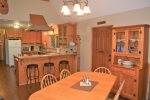 Serve your delicious meals at the spacious dining table or the kitchen counter with bar stools.