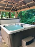 Pour yourself a drink, hop in the hot tub and enjoy mesmerizing natural surroundings.