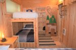 Inviting bunkbeds are a part of another upstairs bedroom.