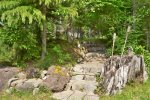 Stone path from driveway down to yard & firepit