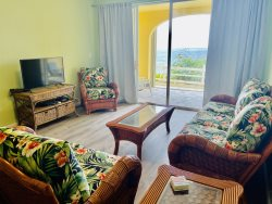 Located in the Gated Community of St. C Condominiums in Mid Island! Gorgeous Ocean Views!