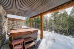 Relax in the large hot tub after a day exploring Big Sky