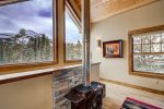 Enjoy the views of loan peak while you play a game of pool and warm by the fireplace